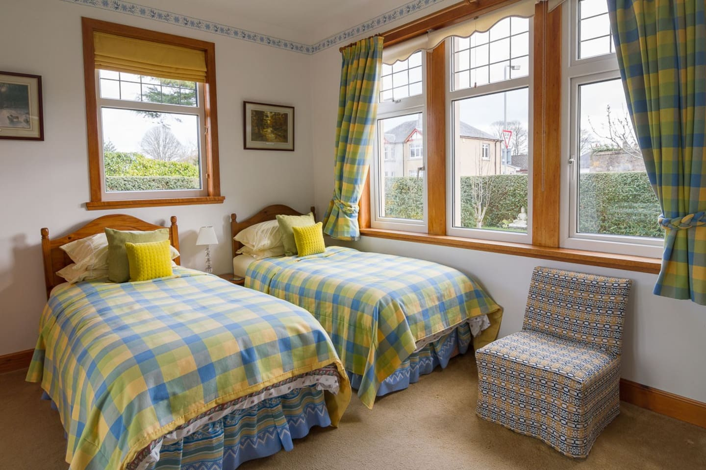 Bright, summer-coloured twin room (two beds) with ensuite and blackout blinds for our very early dawns