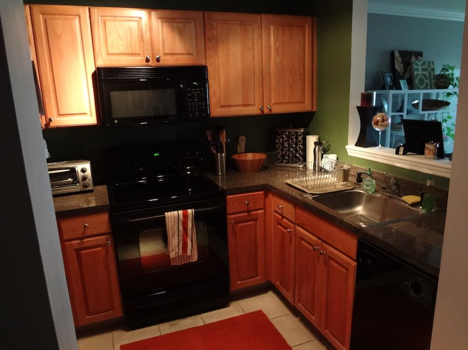 Full functioning kitchen, spacious enough to cook, includes a dishwasher.