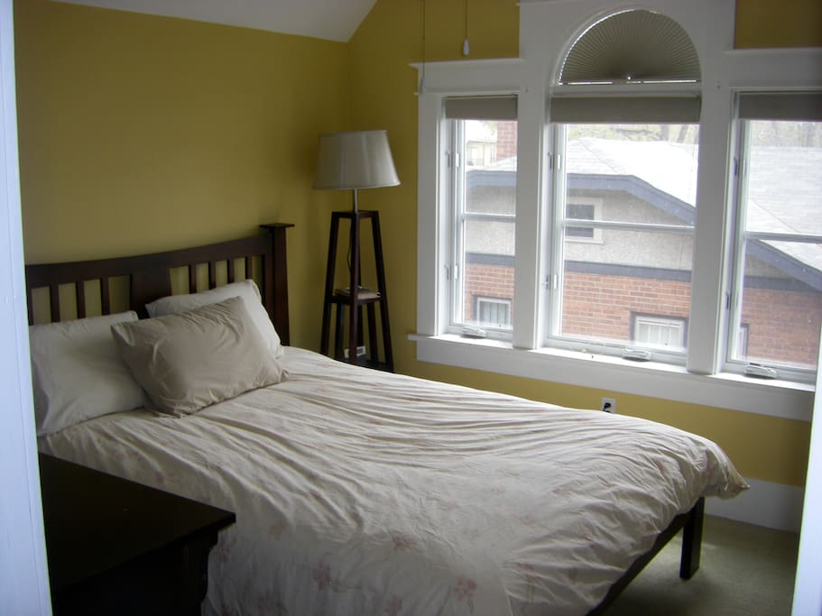 Upstairs guest room with queen bed.  Bathroom with shower in the hallway.