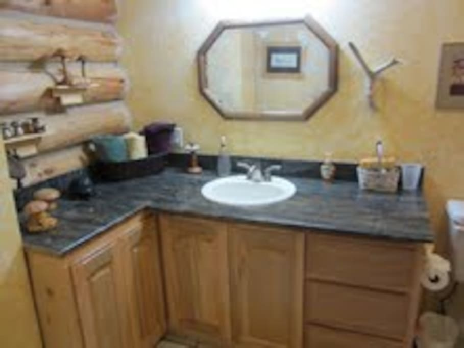 This bathroom with the 3rd bedroom has a tub and shower.