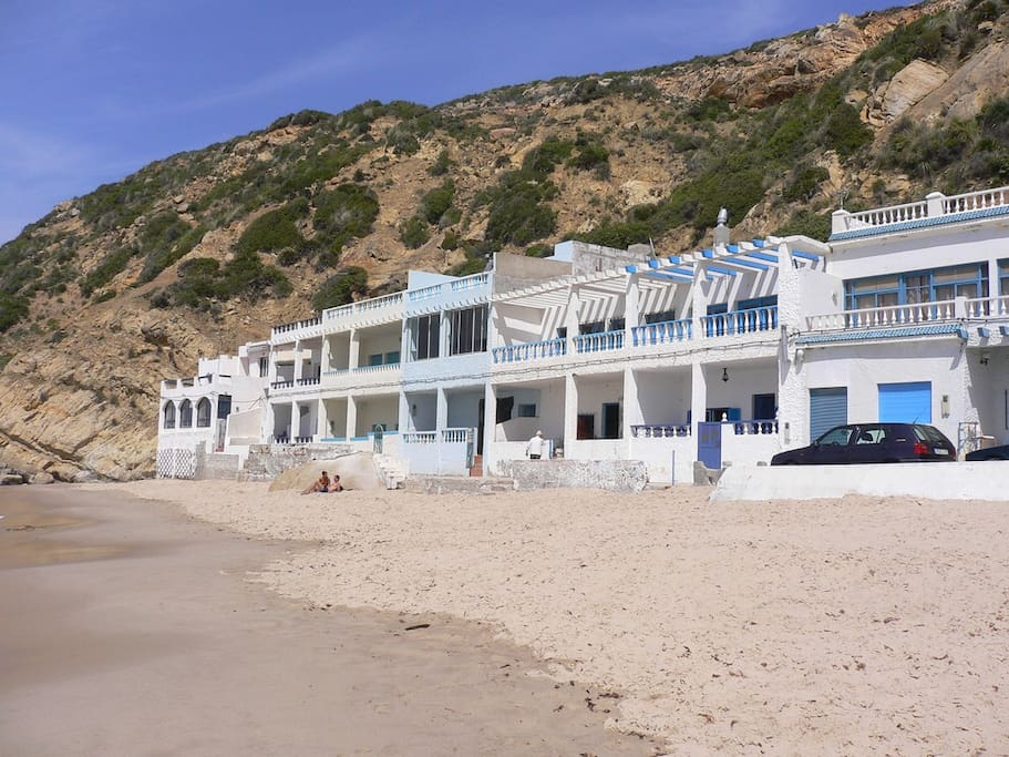 View of the house from the beach (it is the blue one in the middle)
