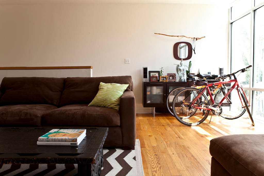 Stylish living room with bikes that can be left for guests!