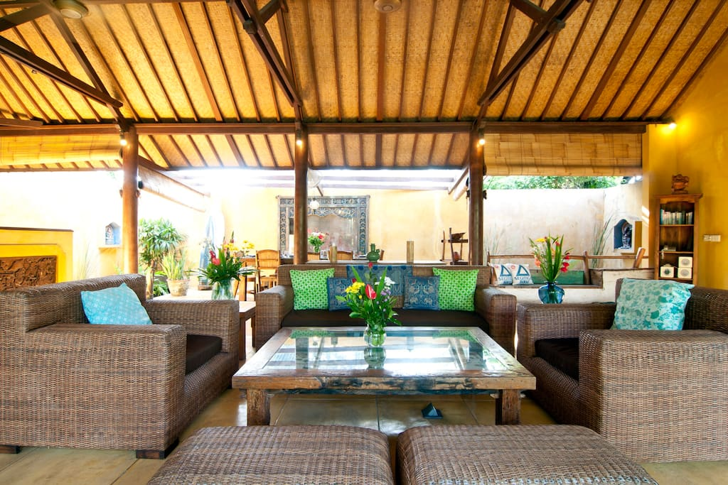 Large comfortable living area opening onto your private pool and tropical lush garden