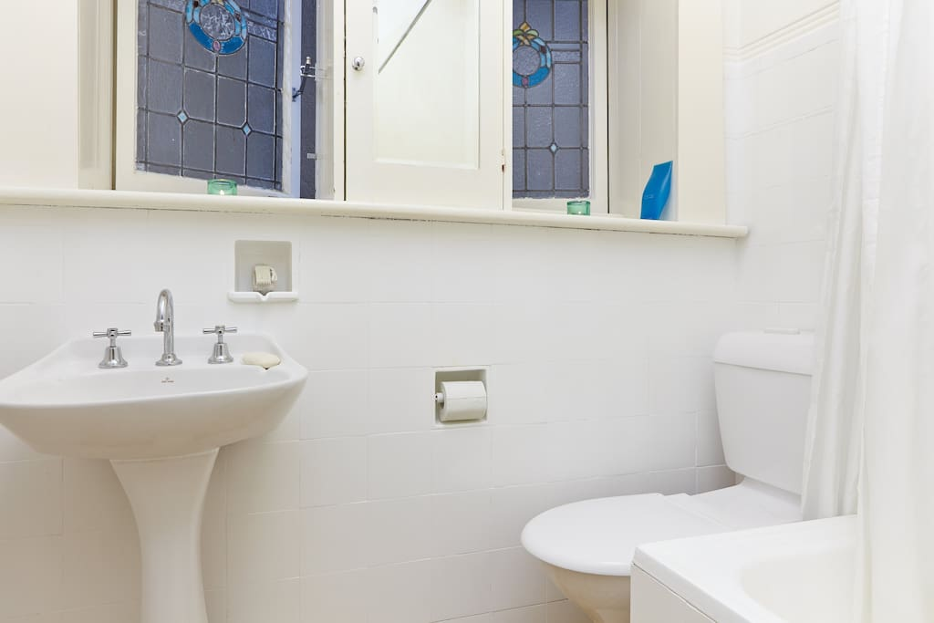 The bathroom has modern finishes yet retains some old-world charm