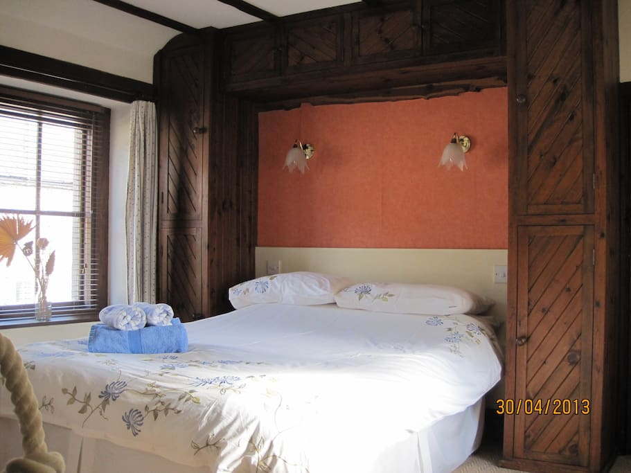 Really comfortable bed with overhead storage and side cupboards
