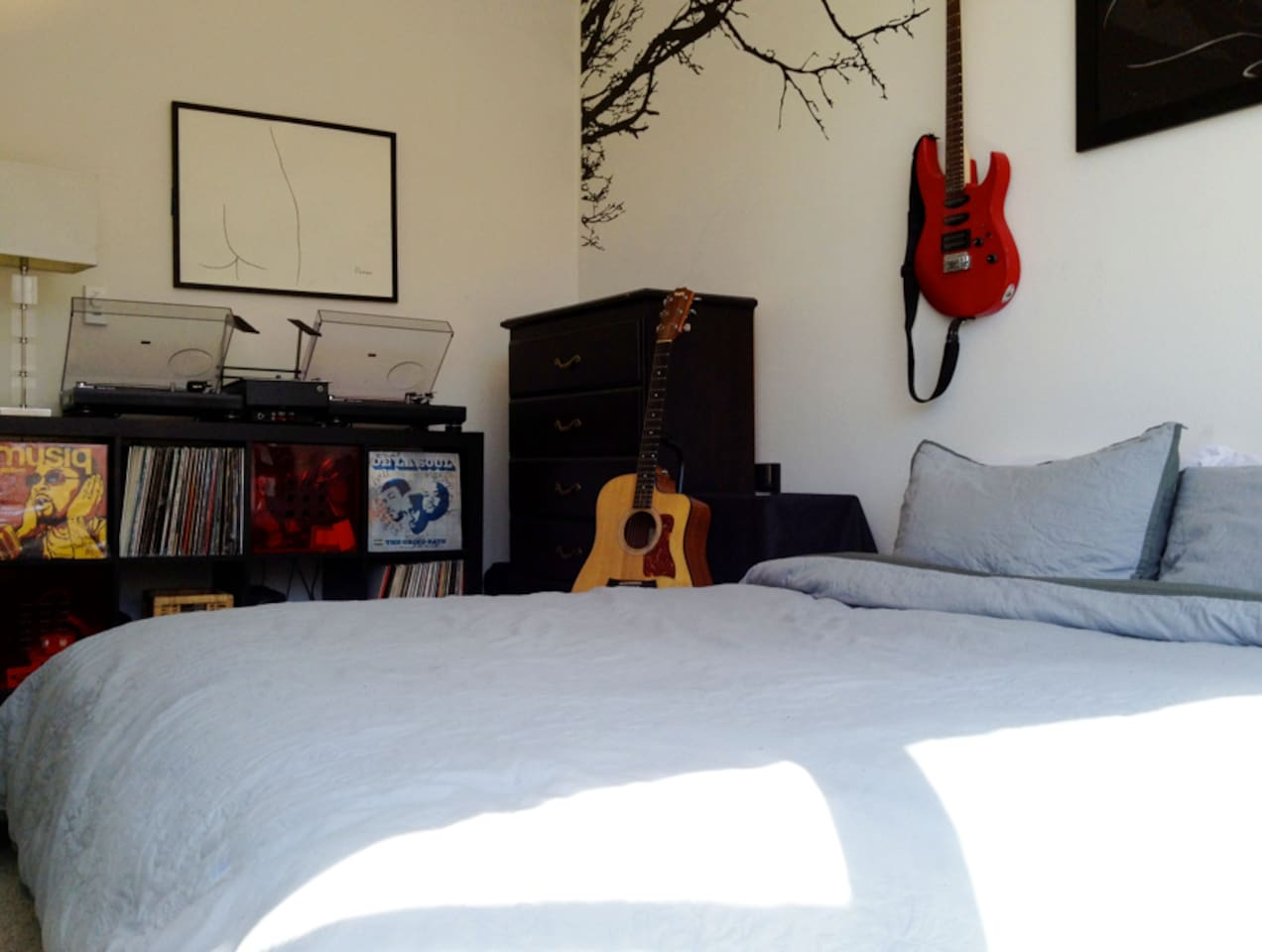 Your own bedroom equipped with a queen bed, baby taylor acoustic guitar, electric guitar, and my decks.