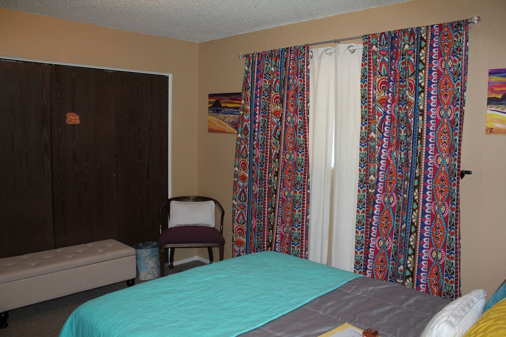 Guestroom with queen bed and blackout curtains. If you need anything during your stay, we're right down the hall.