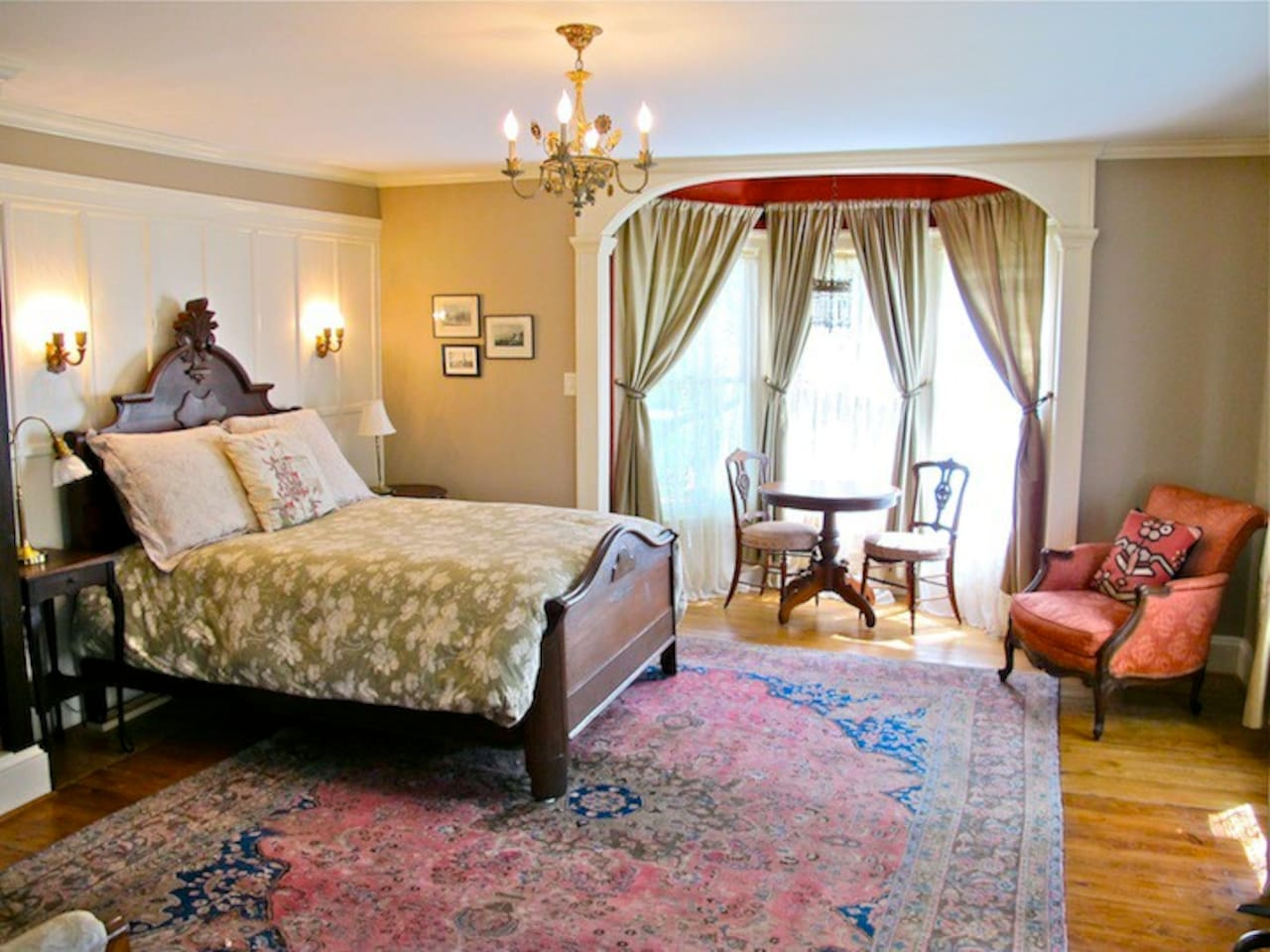 The Green View room has a queen zied bed with armoire, dining set, side chair and love seat