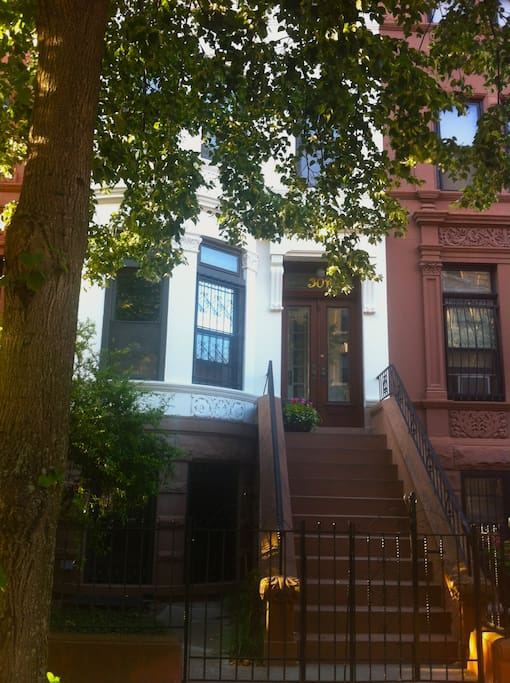 The view of your apartment from the street. (My entrance is at the top of the stoop; yours will be below.)