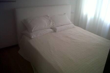 White bedroom at Porta Pia   - Rome - Apartment