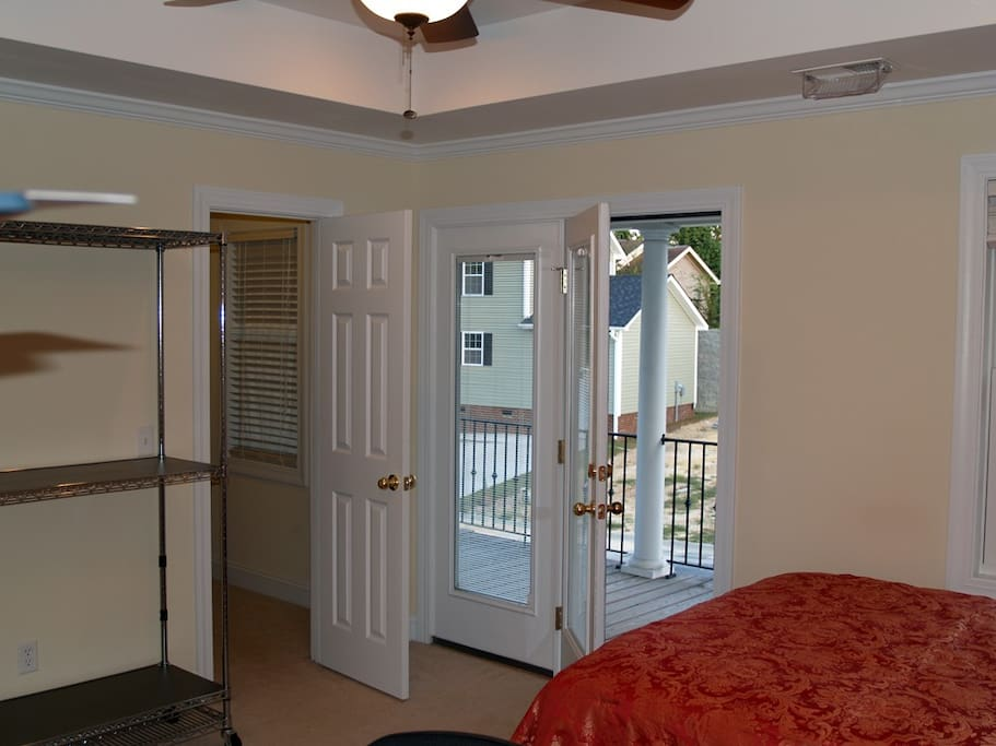 Master Bedroom Suite view of walk-in closet and private balcony.