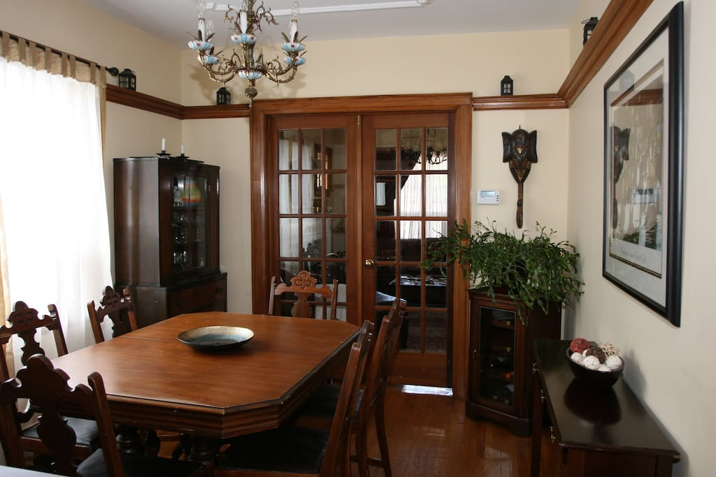 Dining room with large window, French doors, and original wood trim