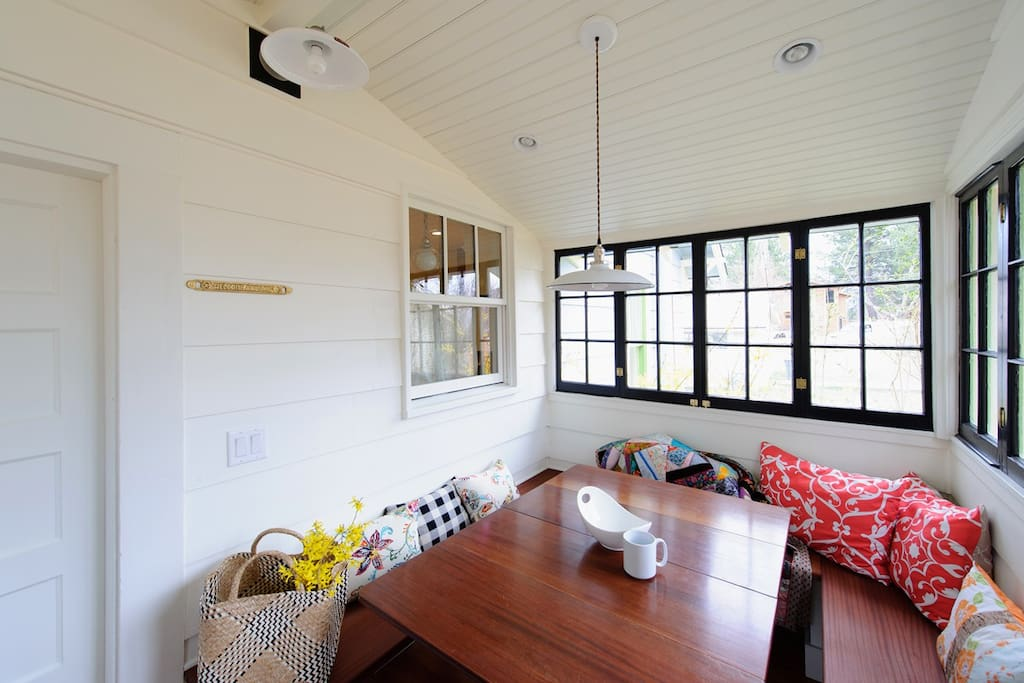Sunroom for morning coffee or game night. The house is stocked with games and guidebooks.