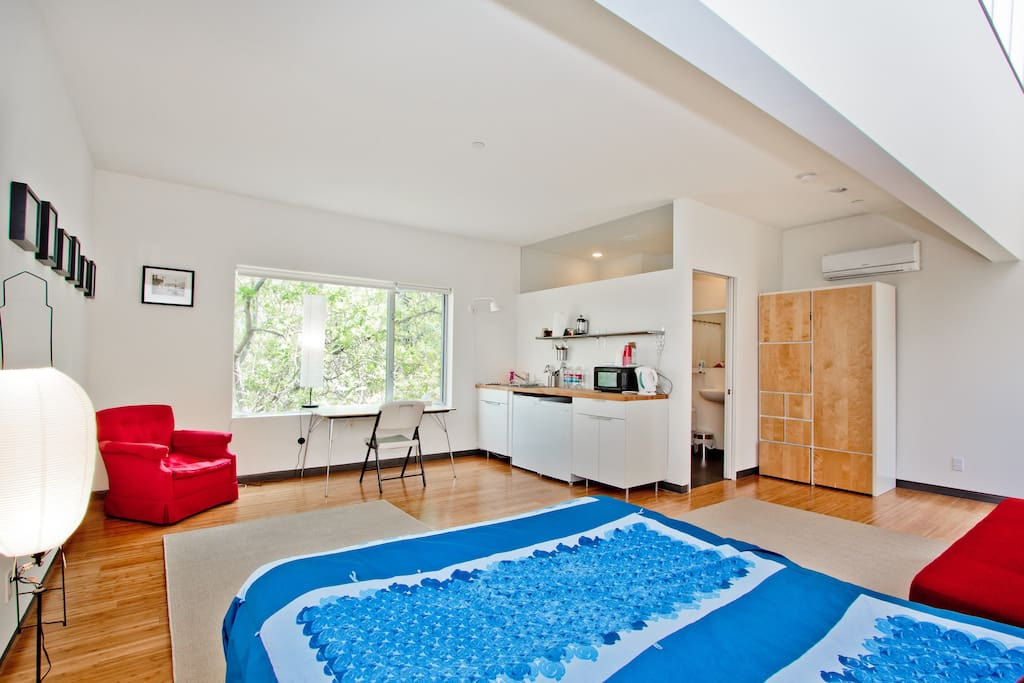 Open and airy main room with clerestory window to bathroom.