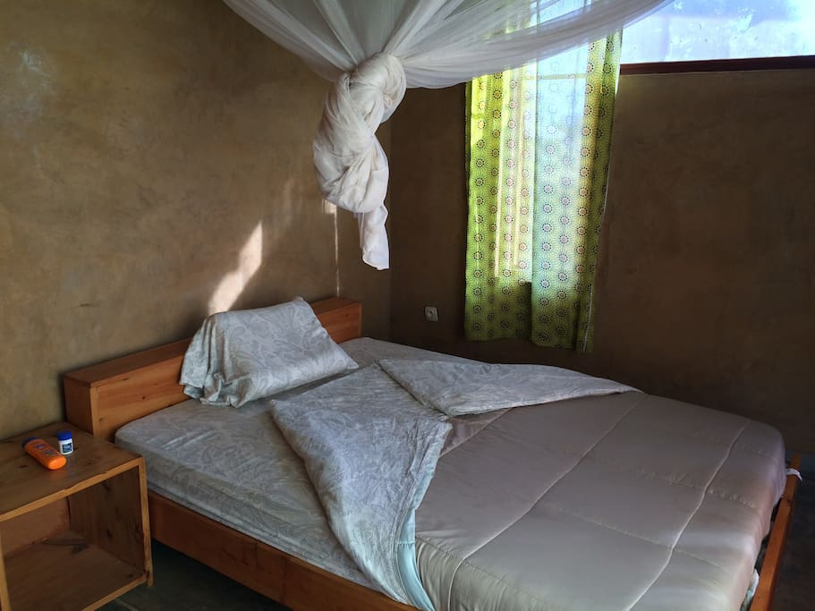 Bedroom 3 - All rooms have queen-sized beds with linens and mosquito nets with closet rods and shelves.