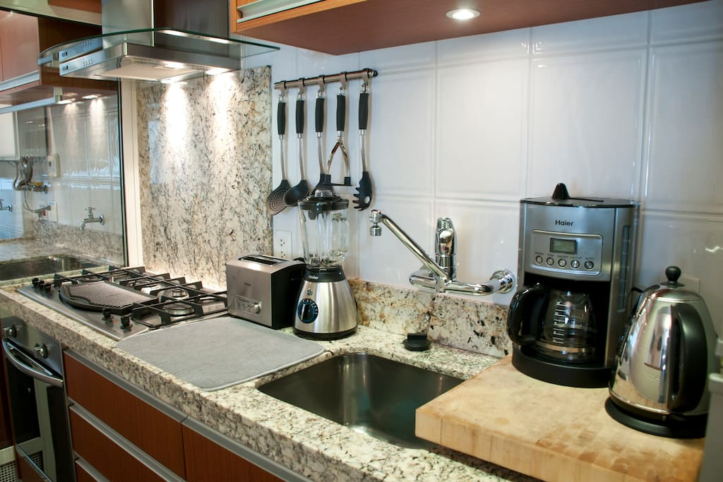 Stylish kitchen with Italian oven and cooktop.  Big wash basins.  Service area w/ clothes washer + dryer.
