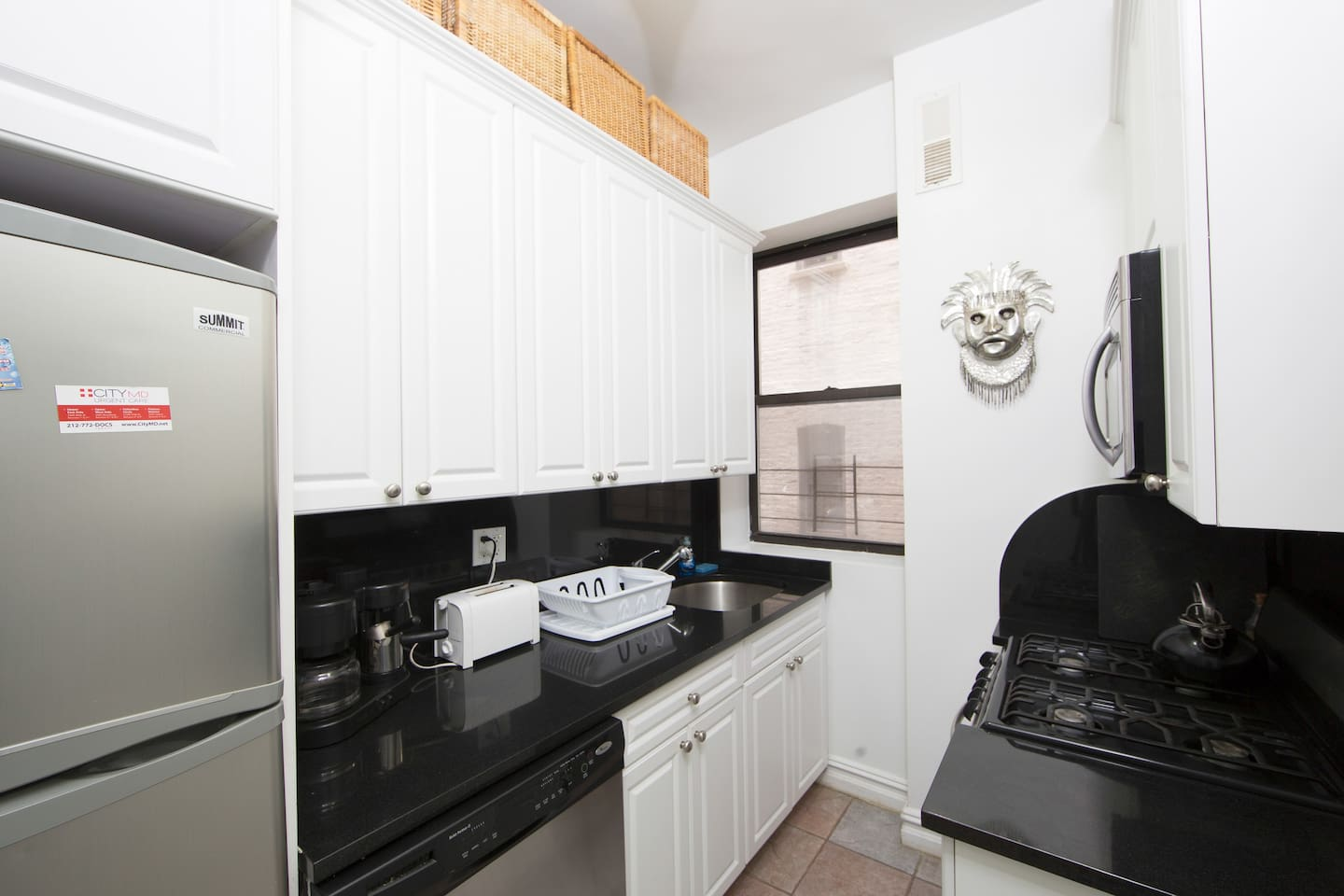 Stainless steel appliances.  Dishwasher, oven, microwave, fridge/freezer and stove.  Pots and pans and everything you need is provided.
