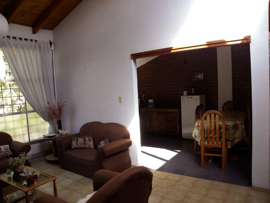 Artwork in the living room, adjacent kitchen visible at left