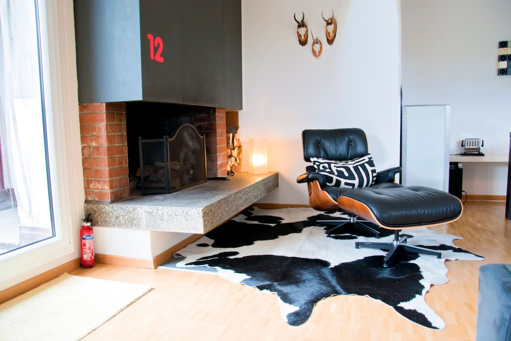 Living room with fire place and lounge chair