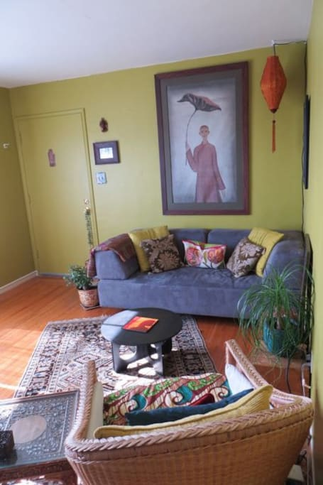 Another view of living room (the backrests of the couch are removable and the couch then becomes a single bed)