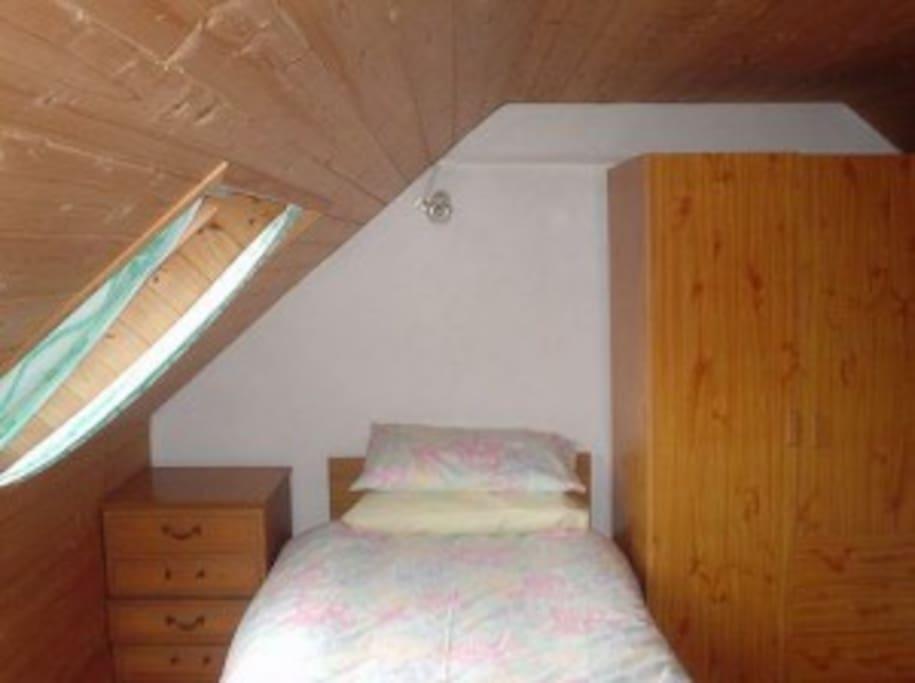 The third bedroom is a cosy twin tucked away under the eaves.