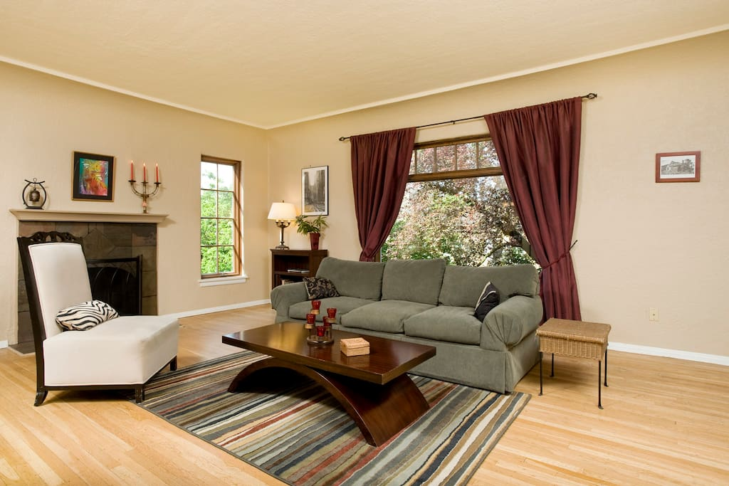 Wood burning fireplace and large entertaining area make this living room warm and inviting