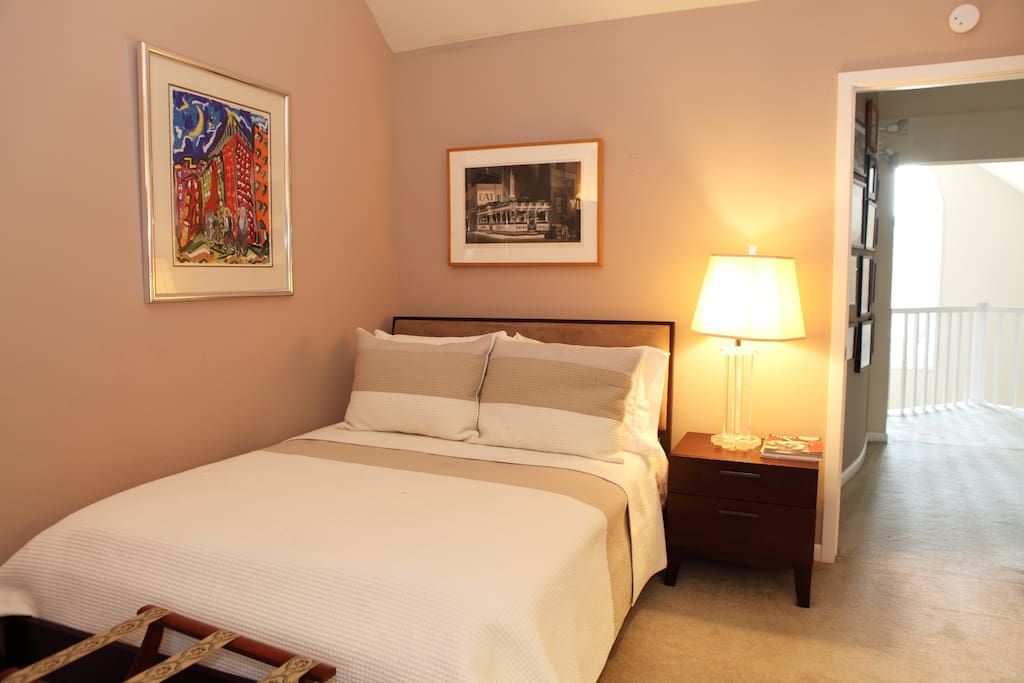 The Guest Bedroom is small with a double bed, best for one adult or two children.