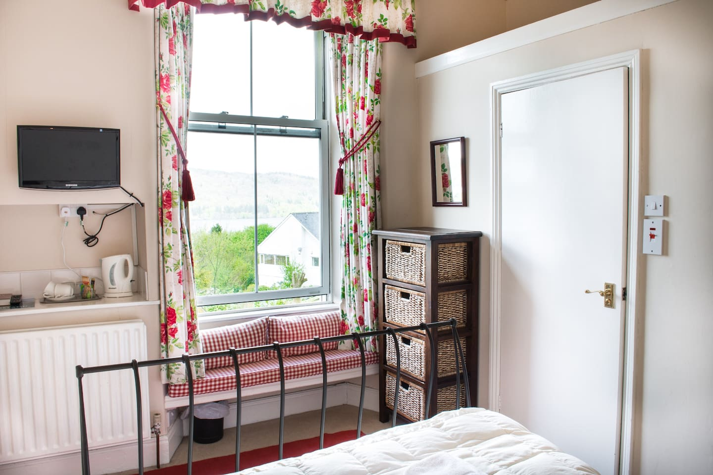 This photo shows guests what you can see from this bedroom. Tea and coffee making facilities, a flat screen TV with Freeview digital channels and digital radio, and a book of things to see and do are available in Claife Heights, as in all our rooms.