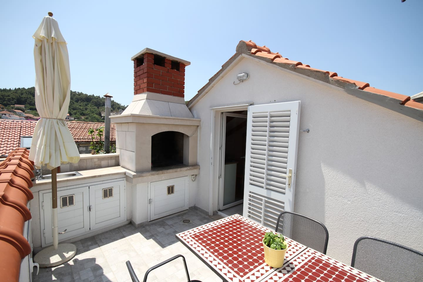 Terrace with fireplace and views of the old town, the marina and the Pelješac