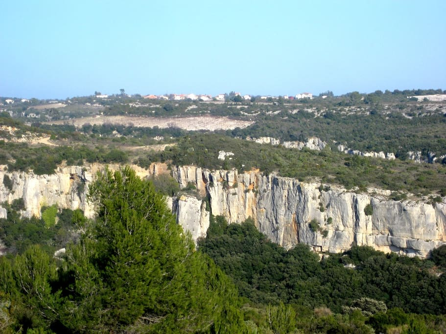 Saint Jean de Minervois, seen from the west, over one of the canyons that crisscross our limestone plateau