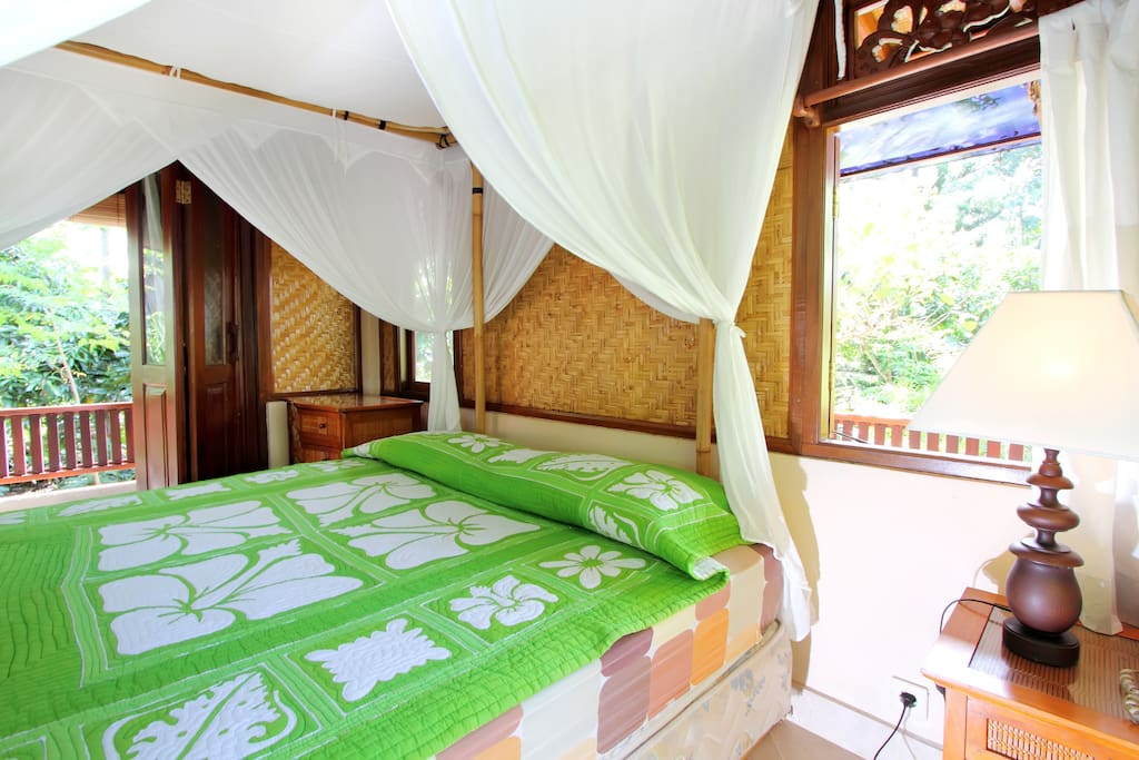Windows or doors on all sides of the room, designed with the breeze in mind. No AC needed, better for you and better for Bali :-)