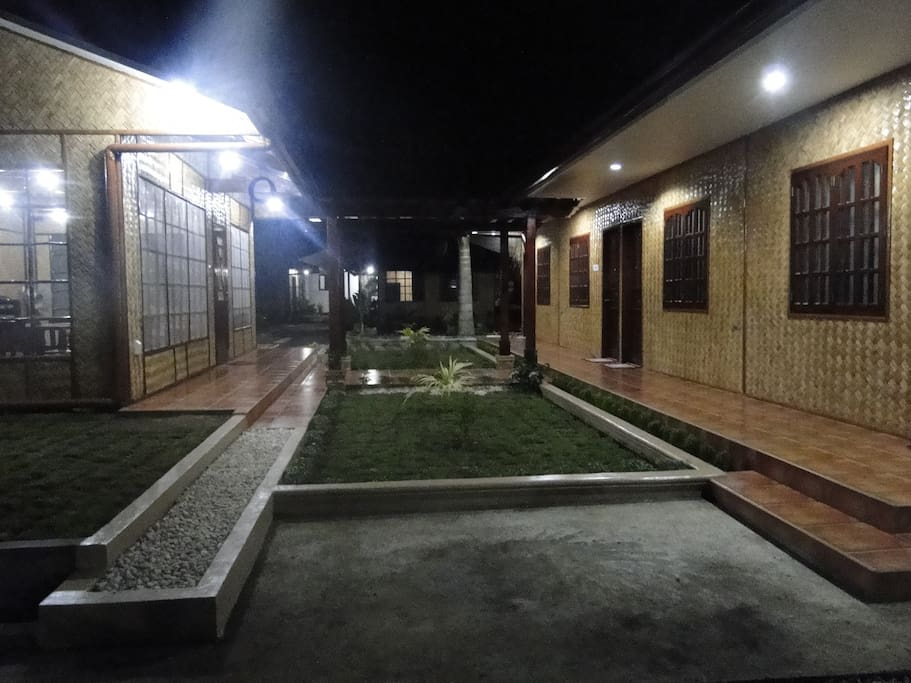 Night view of the bunk-house type apartment on the right and the lounge on the left