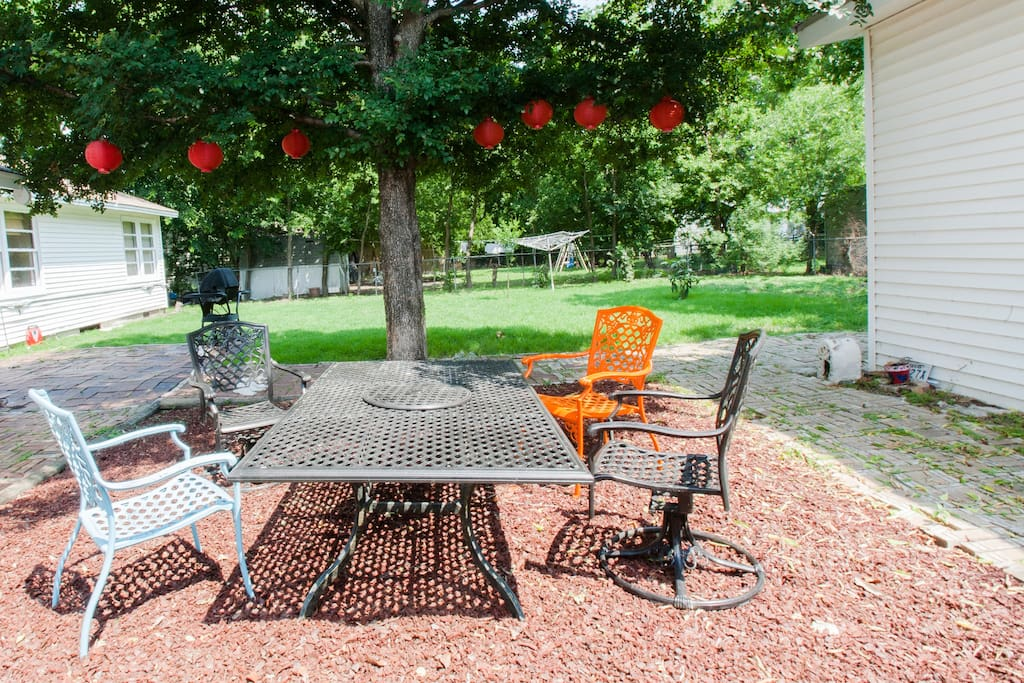 """Hang out with friends or just enjoy dining al fresco at the large """"red lantern"""" tree."""