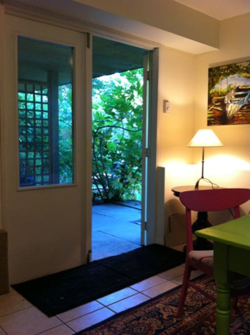 French doors lead out to gardens.