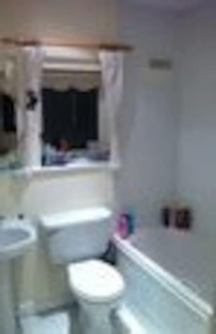 Main family bathroom with shower & bath