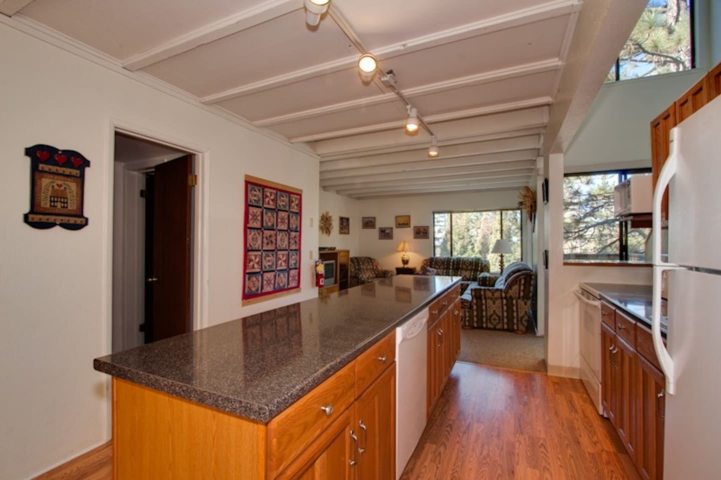 The kitchen and living room.