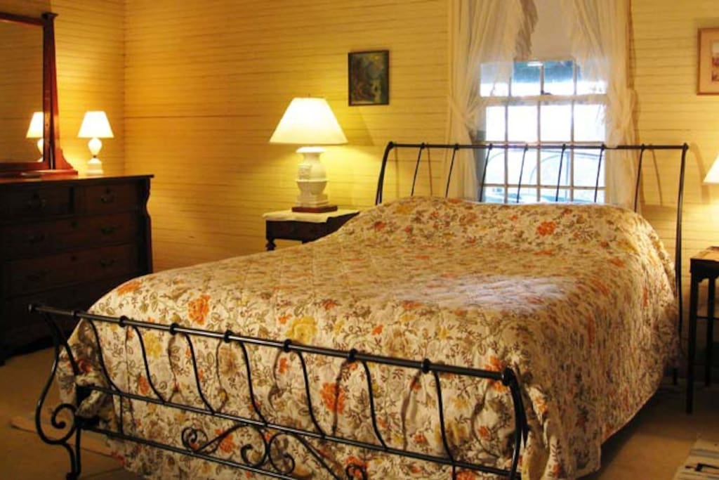 Master bedroom has a queen-sized bed, en-suite bathroom, ample closet and windows on three sides