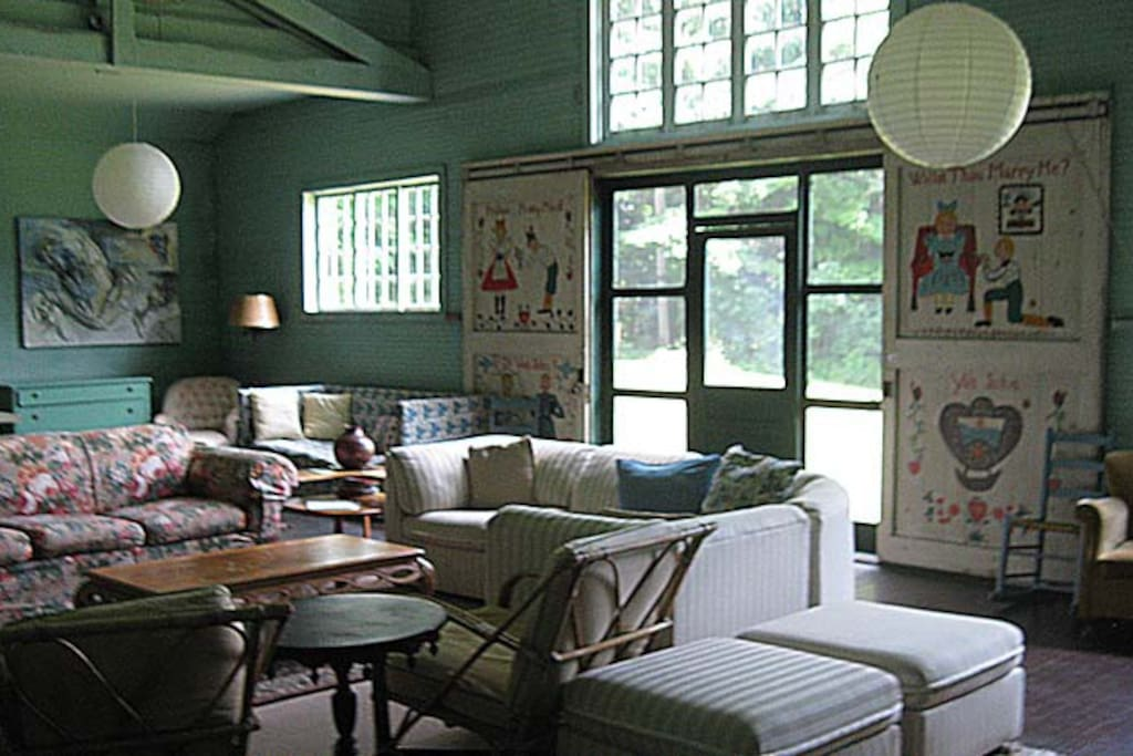 The Great Room has double height ceilings to keep it cool all summer as well as sliding barn doors