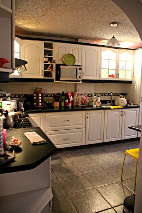 Kitchen with oven, microwave, fridge, washer etc.