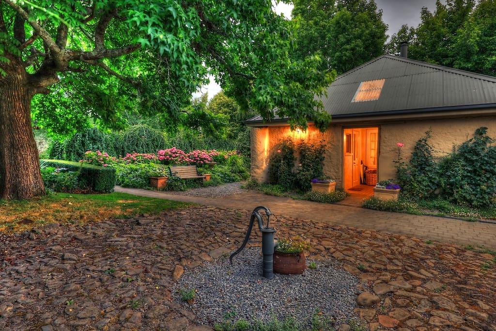 Set within an English style garden.