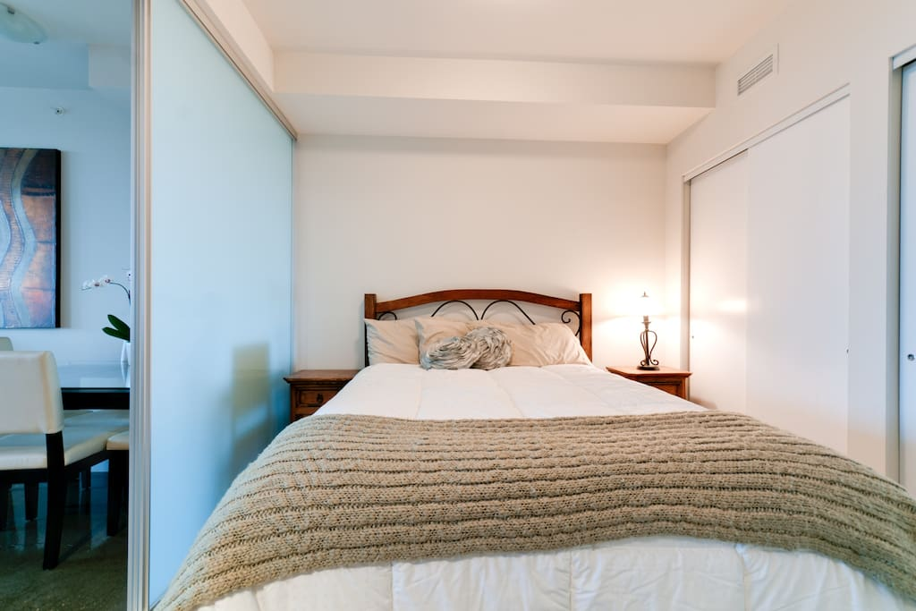 The bed with wrought iron and wood frame. This bed is from the Westin's Heavenly Bed collection!