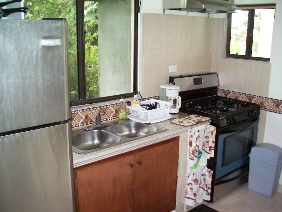 Casita kitchen with full-size 30-inch appliances. Stainless steel double sink.Tile accents from Spain.