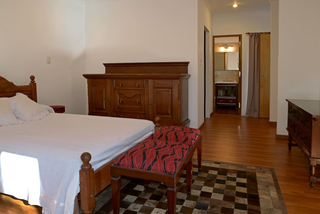 Main Room with king bed, and bathroom in suite.