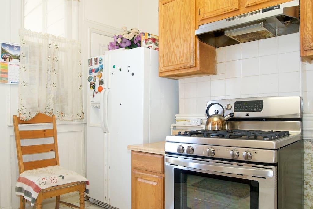 Partial view of the kitchen( stove,fridge etc.)