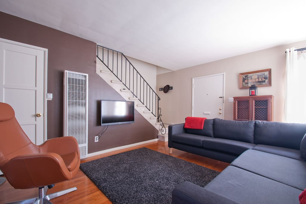 Spacious downstairs area has seating for ten, television features Apple TV, with HuluPlus and Netflix.