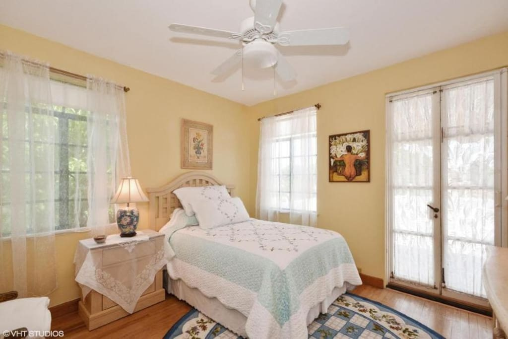 Lovely bedroom with double bed opens to the veranda. Cable TV in room.