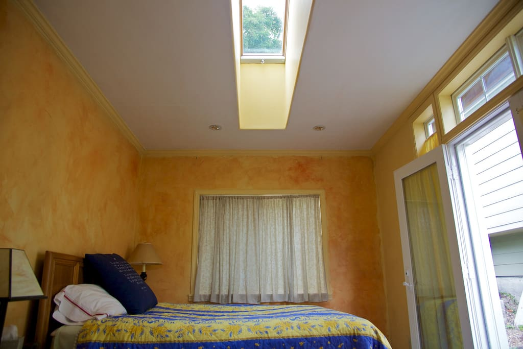 Skylight brings brightness to room.  And it opens for ventilation