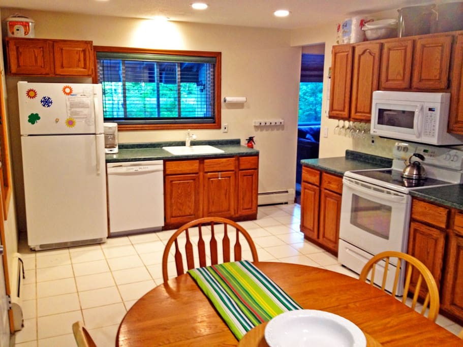 The kitchen is perfect for group dining or hanging out. Lots of space and fully equipped.