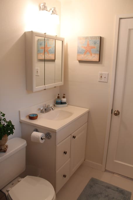 Bathroom with shower and bathtub.  Towels are provided.