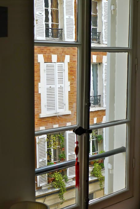 Living room gives onto a charming side street typical of Montmartre